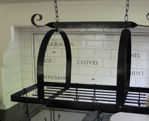 black hanging pan rack kitchen metal