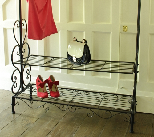 black ornate clothes rail.