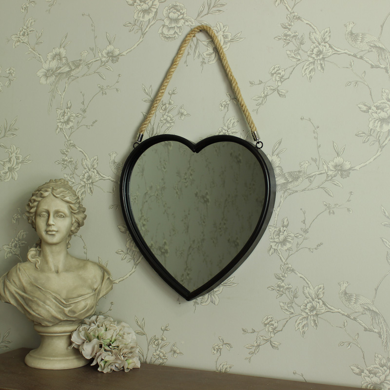 large rustic metal heart hanging wall mirror melody maison. Black Bedroom Furniture Sets. Home Design Ideas