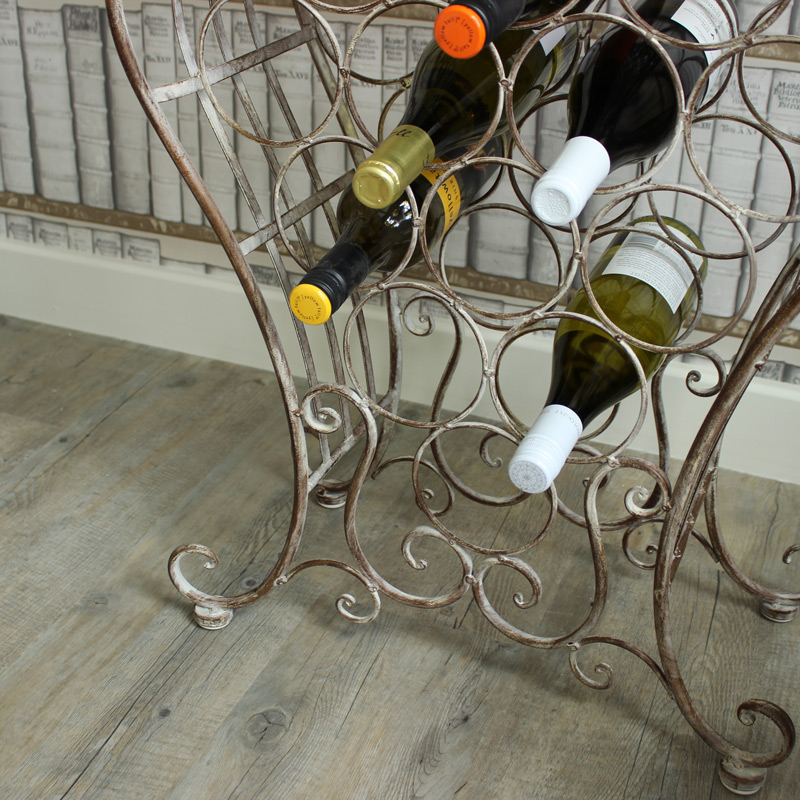 tall ornate metal wine rack with shelves