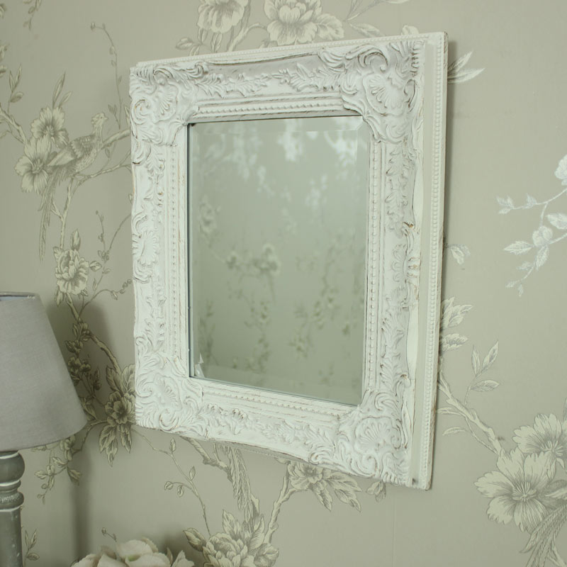 antique white ornate small wall mirror a small white wall mirror in a ...