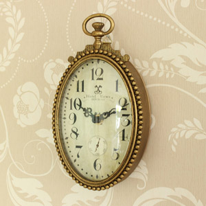 Oval Ornate Gold Wall Clock