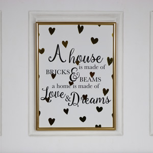 "Gold Framed Wall Plaque ""A house is made of..."""