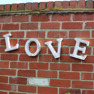 Large Ornamental Stone 'LOVE' Letters