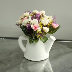 Pretty Flower arrangement in watering can