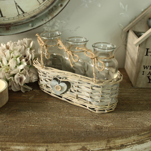 Set of Three Glass Bottles in Wicker Basket