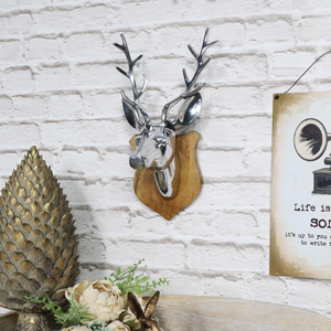 Wall Mounted Silver Stag Head on Wooden Shield