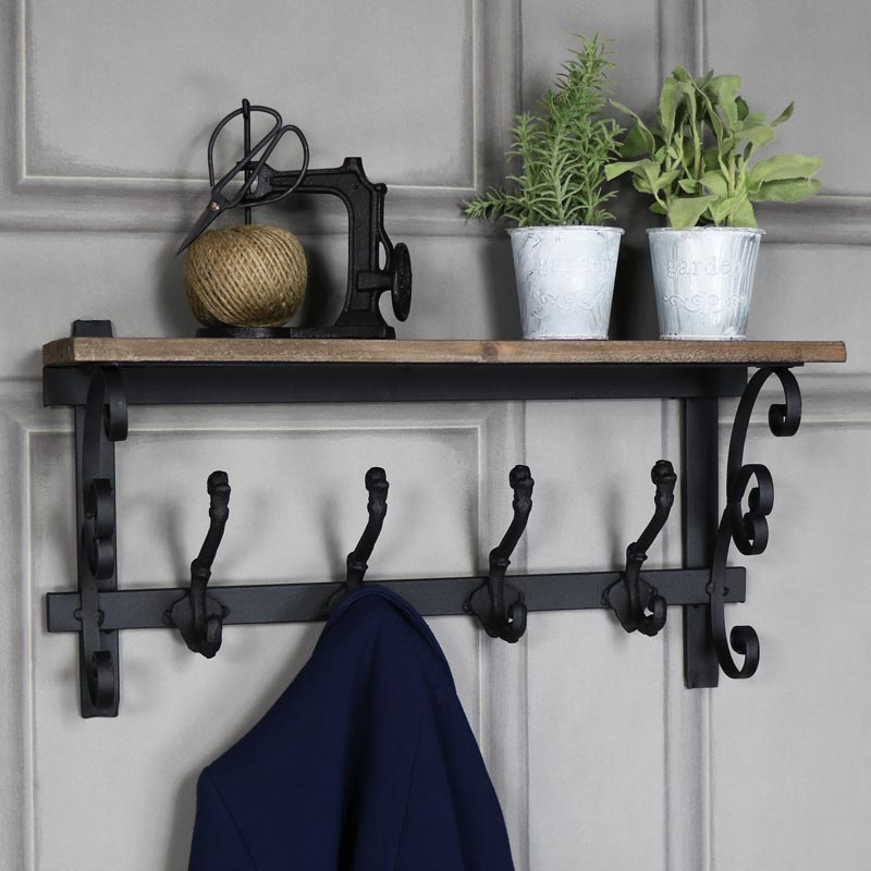 Ornate wooden wall shelf with coat hooks melody maison
