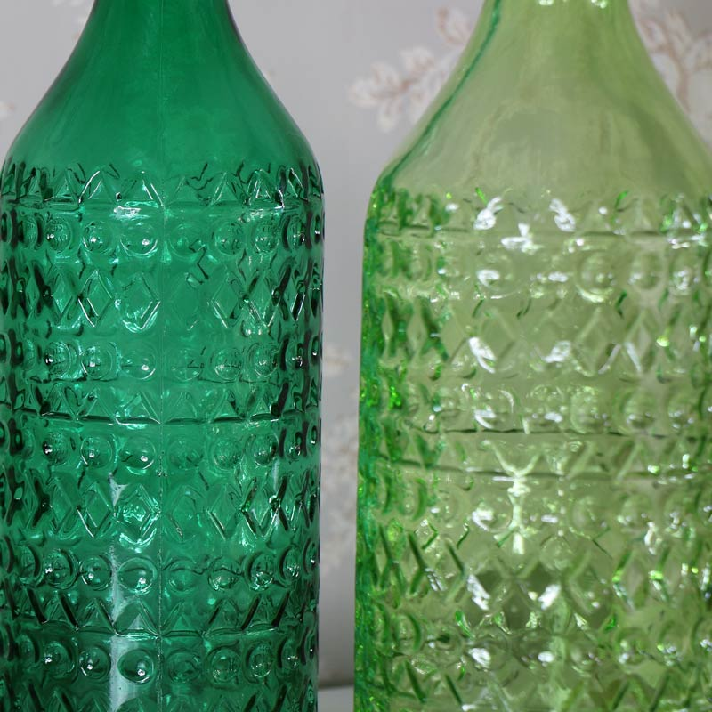Pair of Green Glass Decorative Bottles