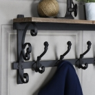 Ornate Wooden Wall Shelf with Coat Hooks