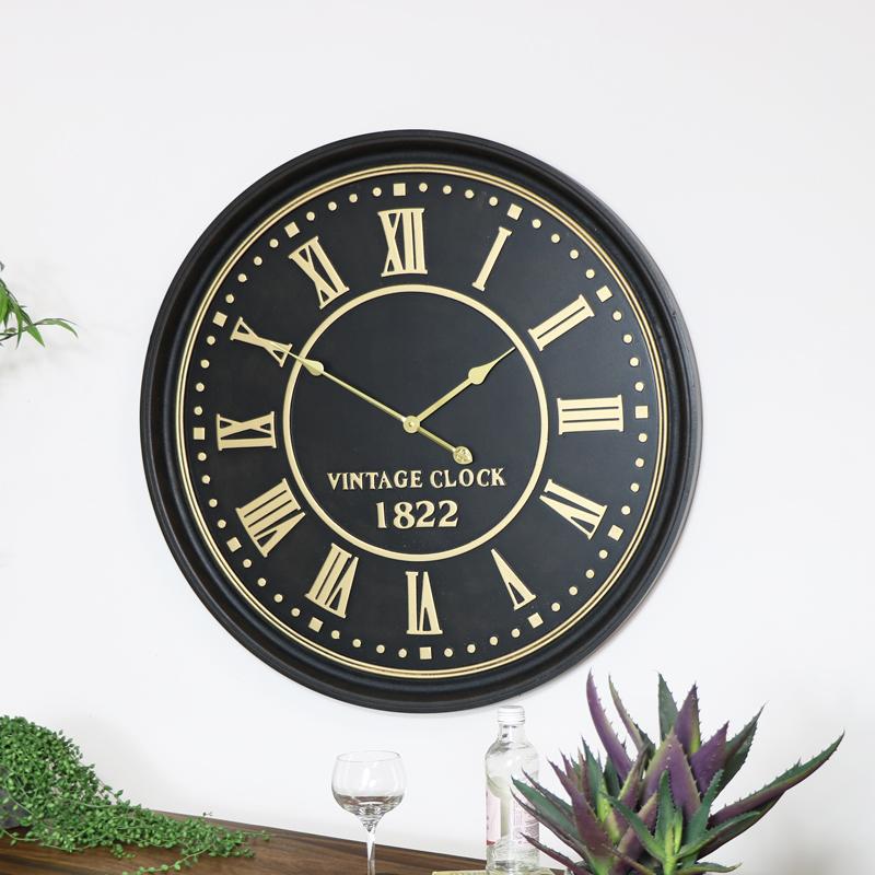 Large Black & Gold Metal Wall Clock