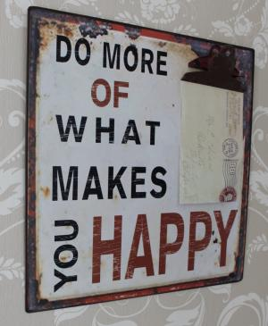 'Do more of what makes you happy' plaque with bulldog clip