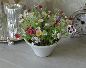 Artificial cottage garden flowers in white vase