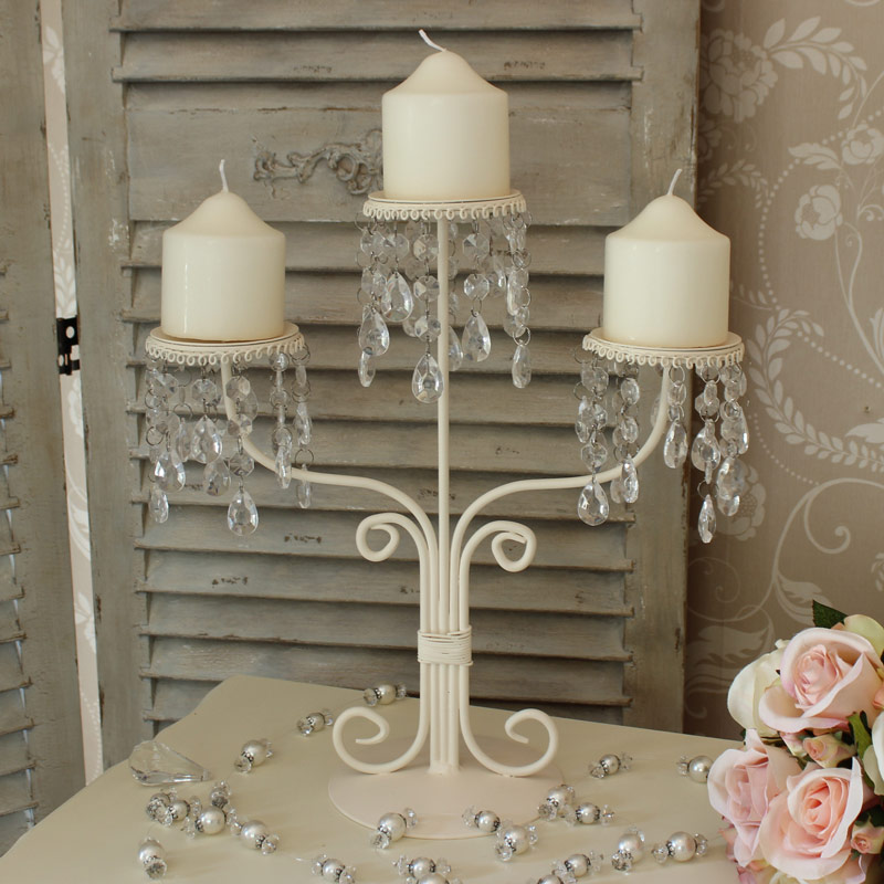 Cream triple Candelabra with ornate crystal droppers